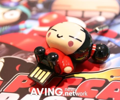 A 'PUCCA' figure USB memory used as a cell phone holder