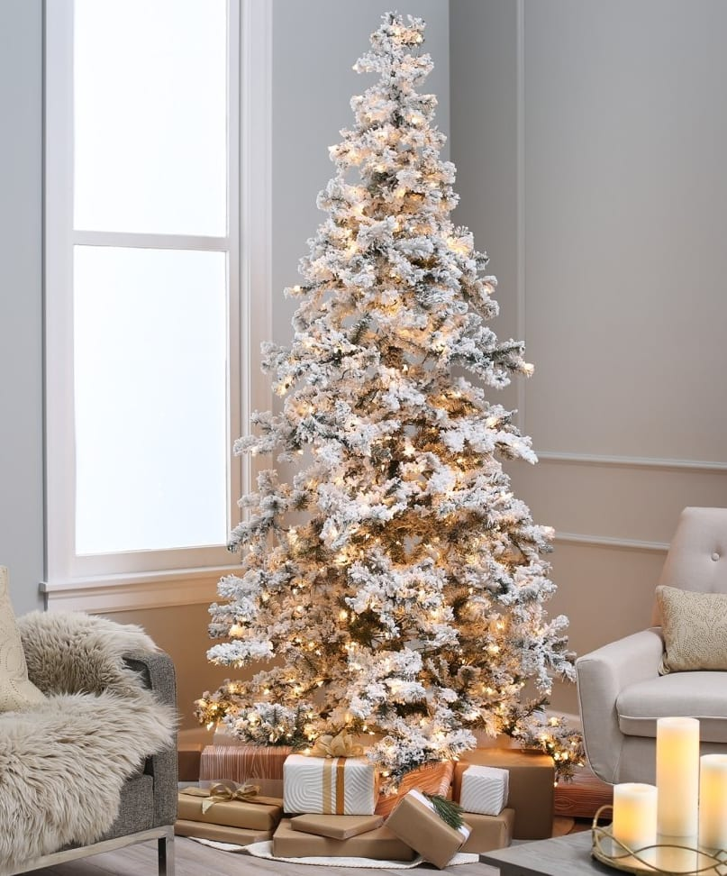 amazingly full artificial tree with a 62 inch width at the base and 1569 tips looks great out of the box or fully decorated with your favorite ornaments