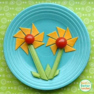 Cuts kids' food into fun-shaped bite-sized pieces