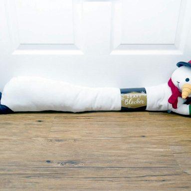 Jumbo Fleece Christmas Friends 36″ Long- Assorted Draft Stopper